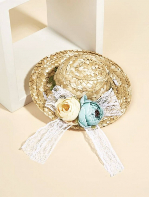 Flower Decor Pet Straw Hat Posed Against A Stand